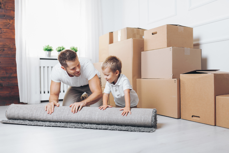 Father and son moving in to a new apartment